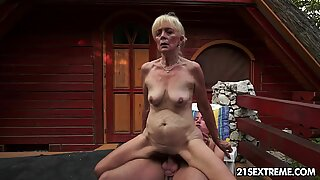 Mature Szuzanne plays with a youthfull cock