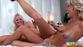 Big breasted blonde lesbians masturbate together with matching pink dildos